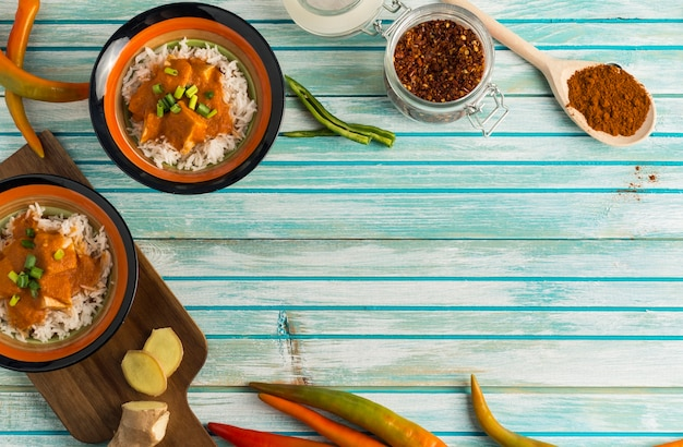 Spices and curry on wooden table Free Photo