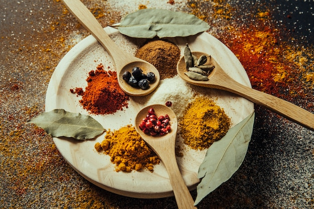 Spices decoration with wooden spoons on plate Free Photo
