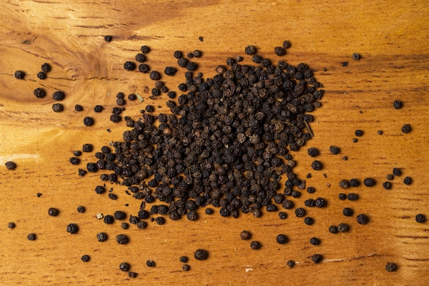 Spices. heap of pepper on the table Free Photo