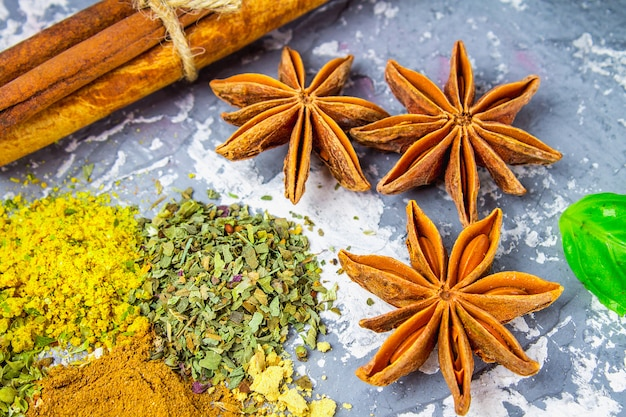 Spices and herbs on a black background Premium Photo