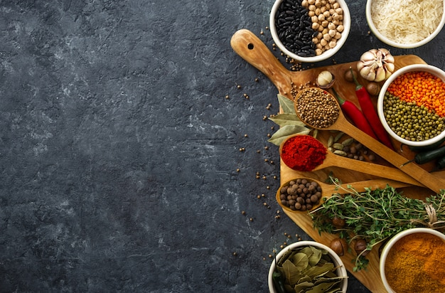 Spices, herbs, rice and various beans and seasonings for cooking on dark backgraund with copyspace top view Premium Photo