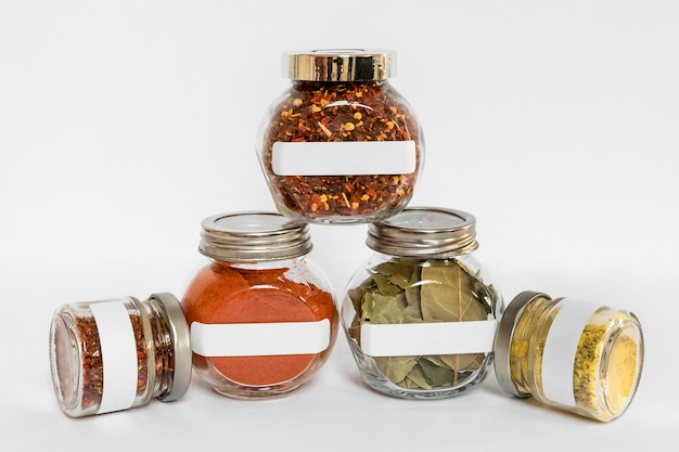 Spices in labelled containers assortment Free Photo