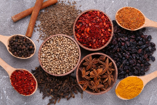 Spices mix on a grey background. top view Premium Photo