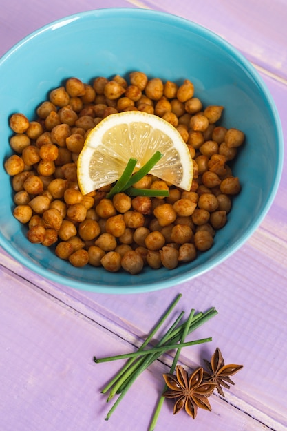 Spices near bowl with chickpea Free Photo
