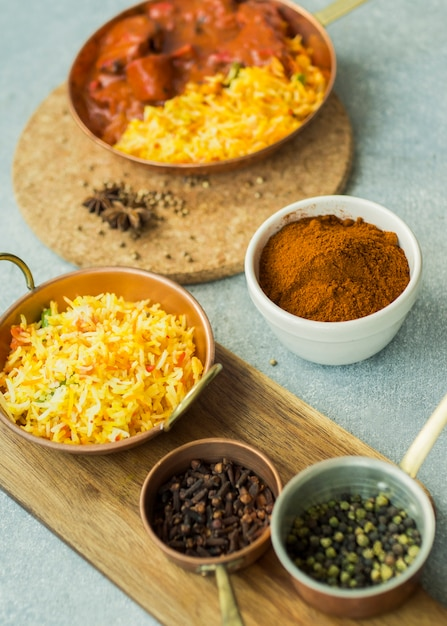 Spices and rice dishes on boards Free Photo