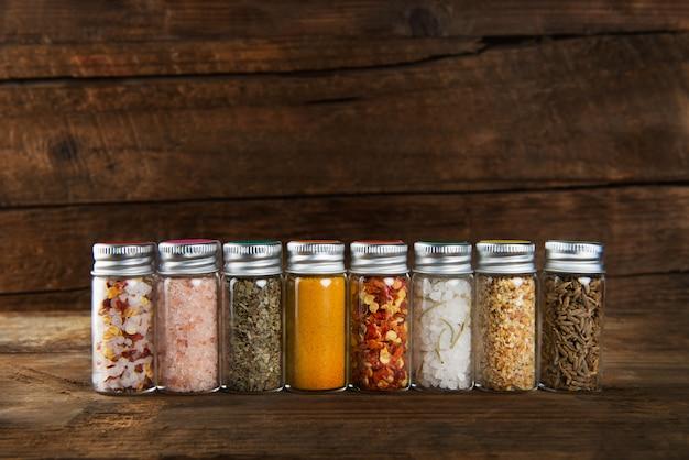 Spices set in mini bottles Premium Photo