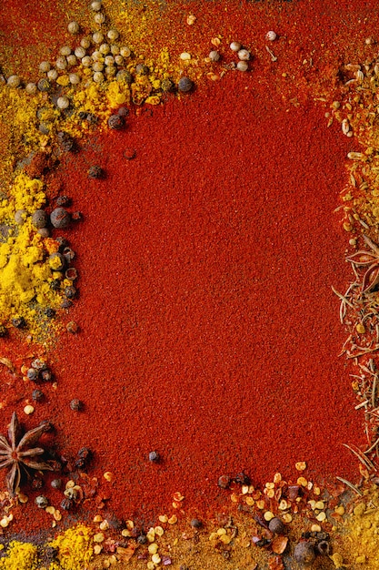 Spicy background with chili peppers Premium Photo