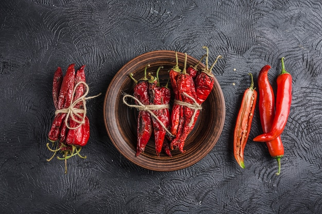 Spicy chili on a dark background in ceramic plates Premium Photo