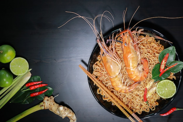 Spicy instant noodles soup with rivers shrimp on top, tom yum kung name in thailand foods style. Premium Photo
