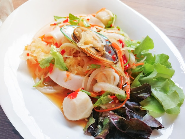 Spicy salad mix seafood plate with squid mussel shrimp and fresh vegetable served Premium Photo