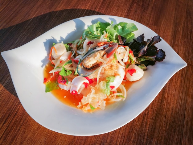 Spicy salad mix seafood plate with squid mussel shrimp and fresh vegetable Premium Photo