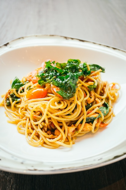 Spicy spaghetti and pasta with salmon Free Photo
