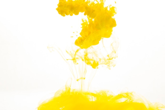 Spill of yellow paint Free Photo