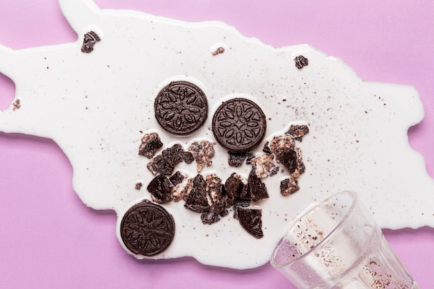 Spilled milk with smashed biscuits Premium Photo