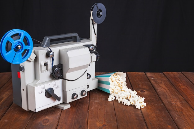Spilled popcorn and movie projector Free Photo