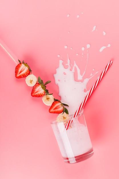 Spilled strawberry banana shake Free Photo