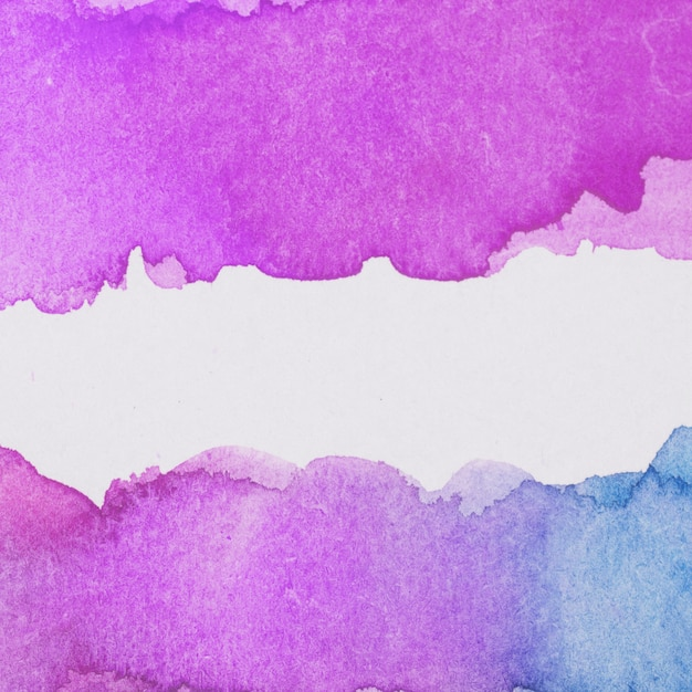 Spills of bright purple and blue paint Free Photo
