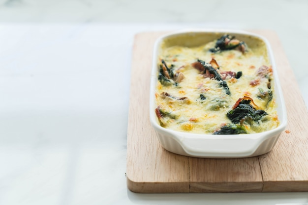 Spinach lasagna in white plate Free Photo