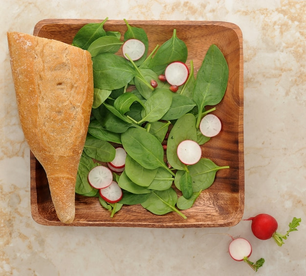 Spinach leaves, eggs, radishes and pomegranate seeds Premium Photo