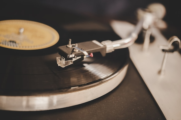 Spinning record player with vintage vinyl Free Photo