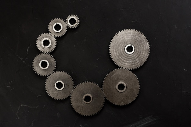 Spiral set of variety cogwheels. steampunk style. spiral sequence concept. flat lay, top view. Premium Photo