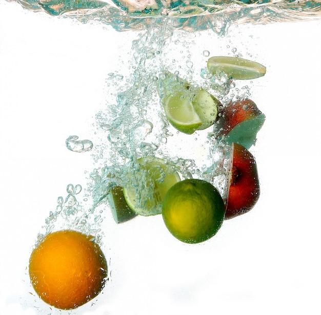 Splash water with freshnes fruits Free Photo