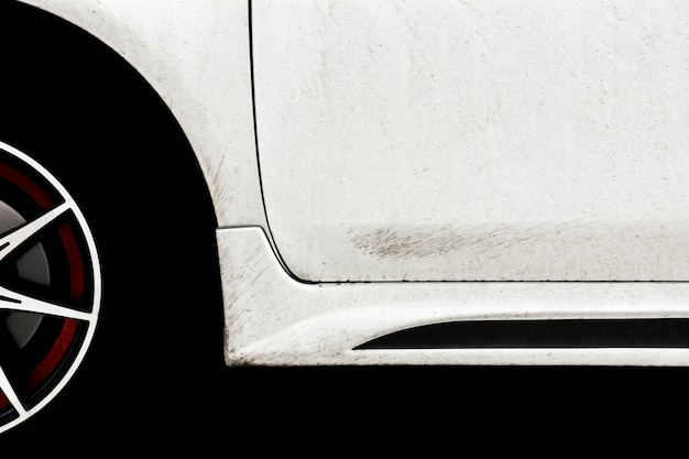 Splashes of mud from wheel on a white car Premium Photo