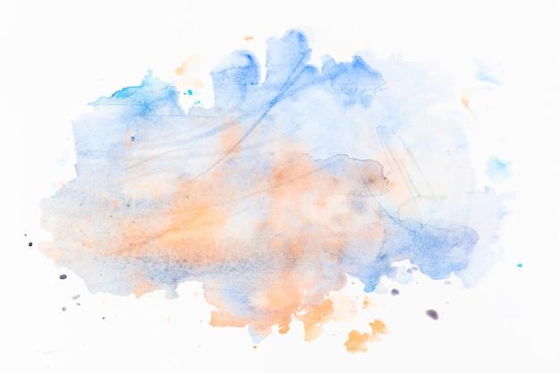 Брызги светло-голубой и оранжевой краски Premium Фотографии