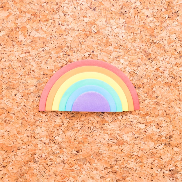 Sponge rainbow placed in center of cork board background Free Photo