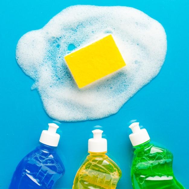 Sponge with soap and washing liquids Free Photo