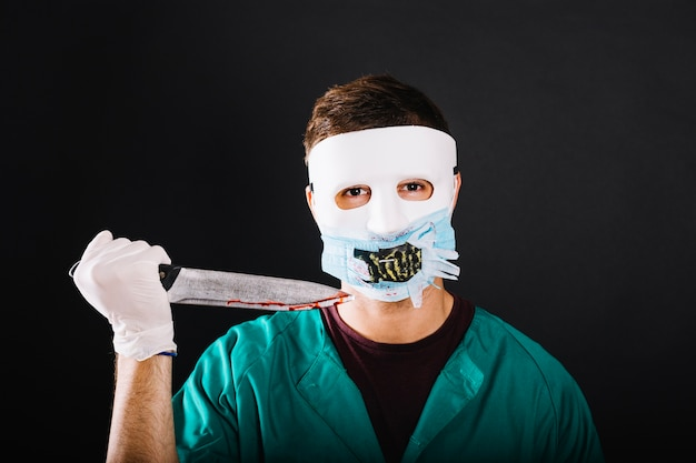 Spooky doctor with knife Free Photo
