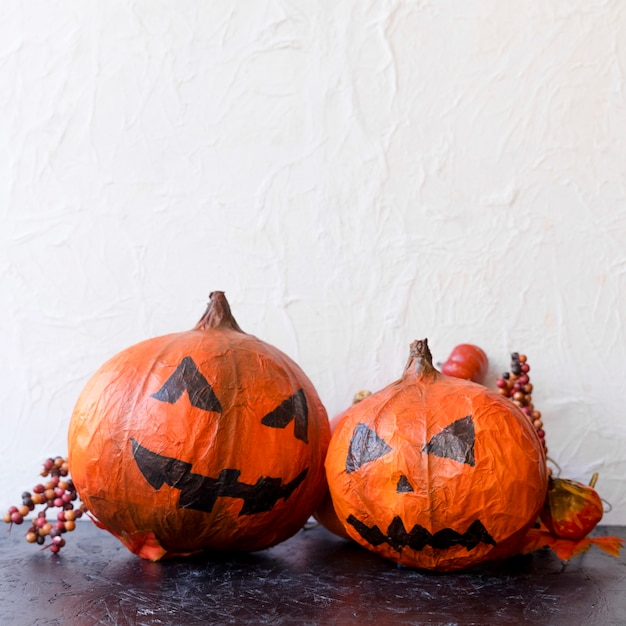 Spooky jack-o-lanterns and berries Free Photo