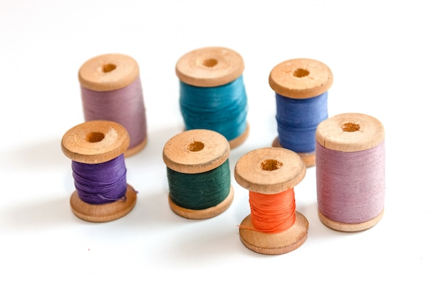 Spool of thread isolated on white background, sewing supplies and accessories Premium Photo
