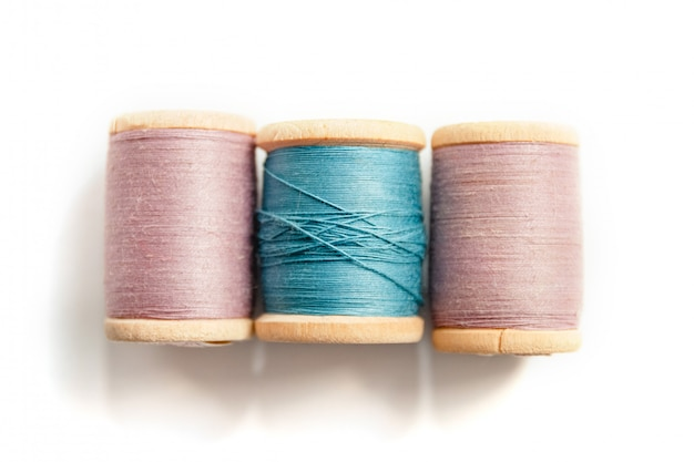 Spool of thread isolated on white background in soft focus, sewing supplies and accessories Premium Photo