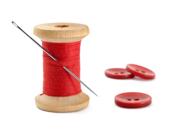 Spool of thread, needle and buttons isolated on white Premium Photo