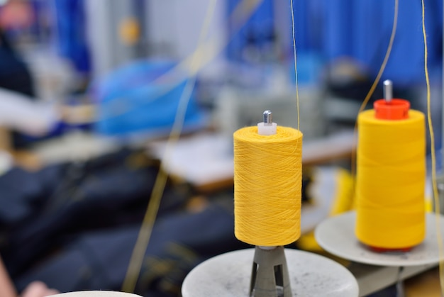 Spools of thread in the sewing equipment. the concept of sewing production. Premium Photo
