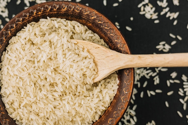 Spoon in bowl with rice Free Photo
