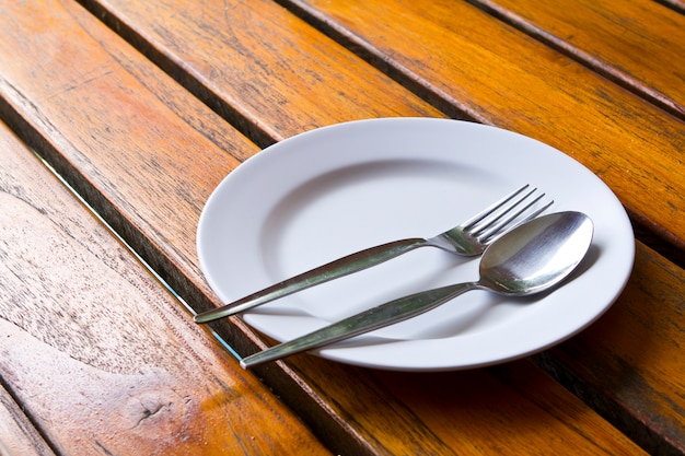 Spoon and fork on a plate Free Photo