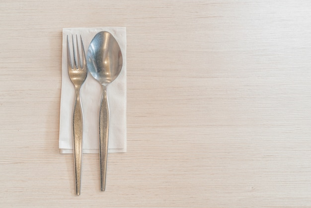 Spoon and fork on table Free Photo