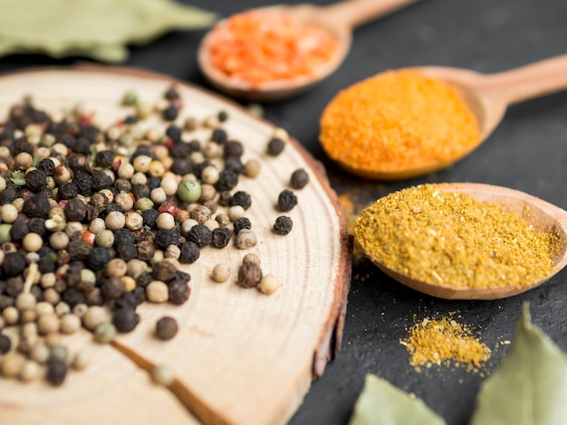 Spoon full of spices and trunk piece Free Photo