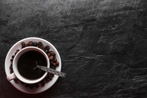 Spoon in cup of coffee Free Photo