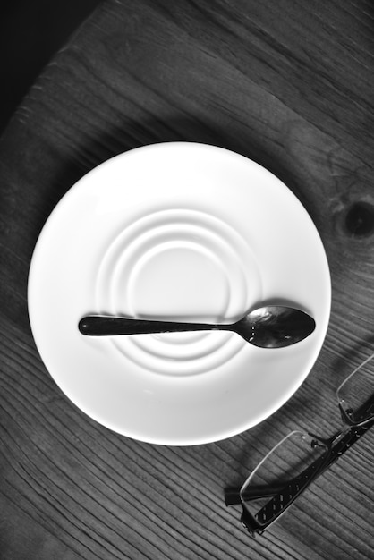 Spoon on a plate Free Photo