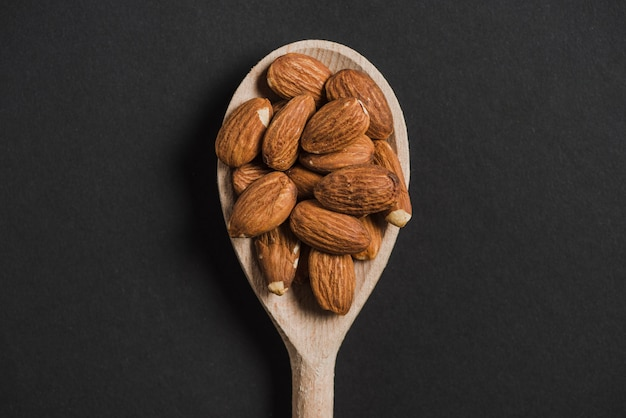 Spoon with almonds Free Photo