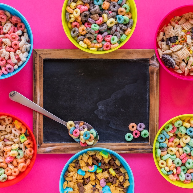Spoon with cereal on chalkboard Free Photo