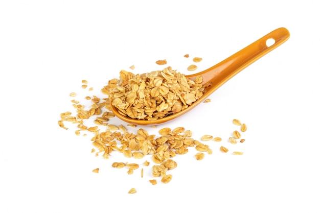 Spoon with granola on white Premium Photo