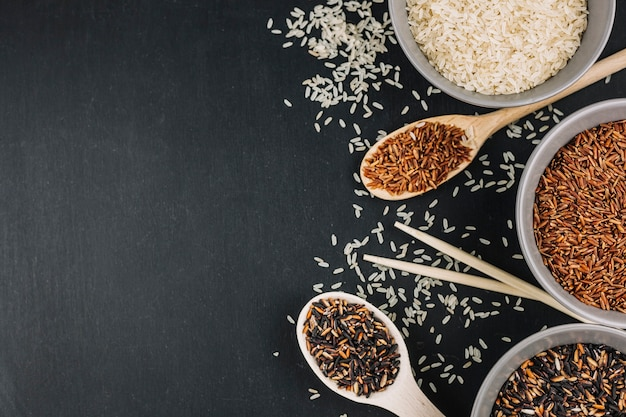 Spoons and bowls with assorted rice Free Photo