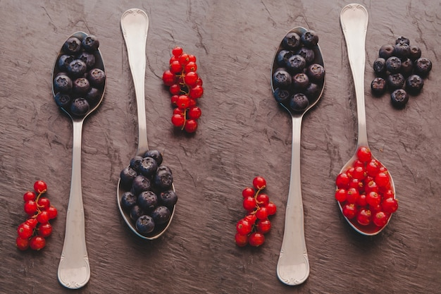Spoons with red fruits Free Photo
