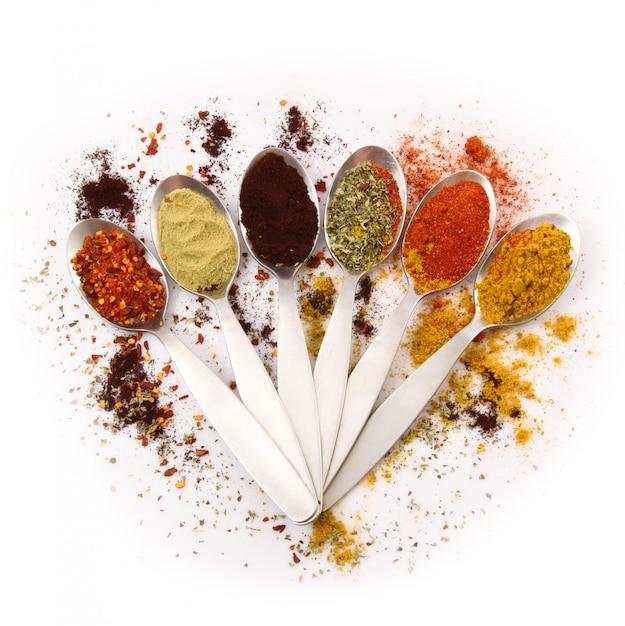 Spoons with spice Premium Photo