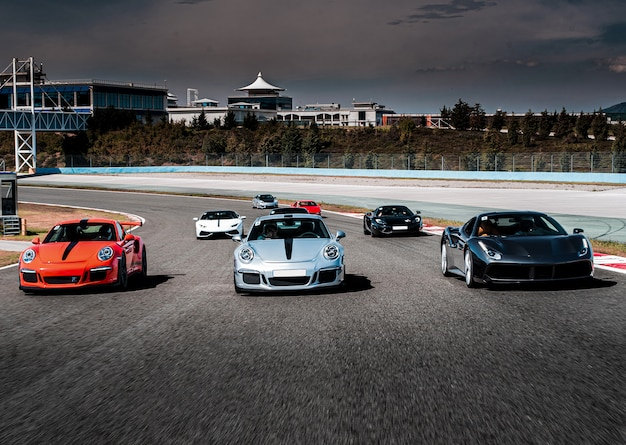 Sport cars parade or race on the highway. Free Photo