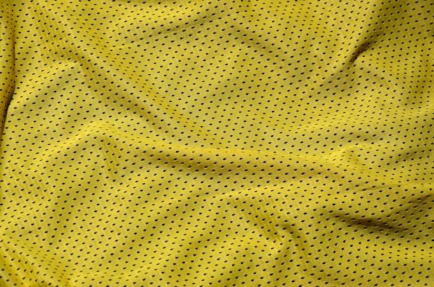 Спортивная одежда ткани текстуры фона, вид сверху Premium Фотографии